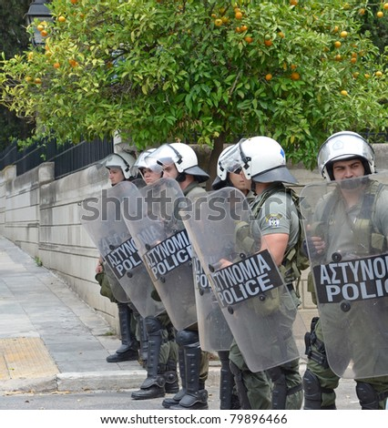 ATHENS, GREECE - JUNE 15: General strike against new $40.36 billion austerity program of tax hikes and sell-offs of state property on June 15, 2011 in Athens, Greece. Greek riot police block access to central square