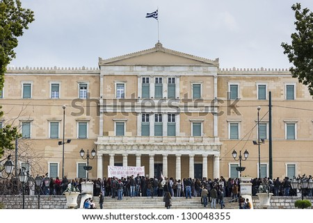 ATHENS,GREECE - MAR 02 : Greek protesting in front of the Greek Parliament against the new austerity measures and the job losses, March 02, 2013 in Athens,Greece