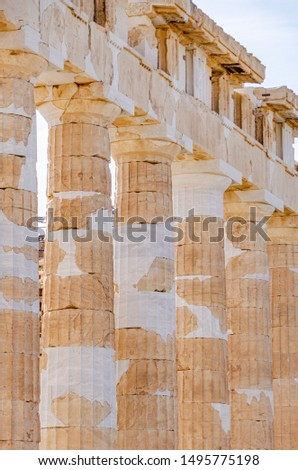 ATHENS, GREECE – NOVEMBER 3, 2018: Detail of the doric columns of famous ancient Greek temple of Parthenon after reconstruction. Visible white stains indicate new pieces of marble.