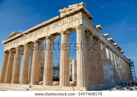 ATHENS, GREECE – NOVEMBER 4, 2018: Famous ancient Greek temple of Parthenon on the top of Acropolis dedicated to the goddess Athena. Built in the 5th century BC, currently under reconstruction.