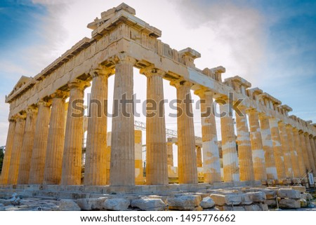 ATHENS, GREECE – NOVEMBER 3, 2018: Ruins of famous ancient Greek temple of Parthenon in backlight. Built in the 5th century, now under reconstruction. Visible stains indicate new pieces of marble.