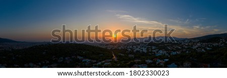 Athens Greece panorama at sunset. Sundown over Athens city, aerial drone view from Penteli mount Foto stock ©