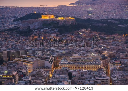 Athens skyline aerial view in the afternoon with the lights over blue hour, the Parthenon is visible