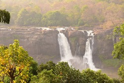 Athirapally waterfalls with golden light