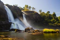 Athirappilly waterfall, at 80 feet, this waterfall is largest waterfall in Kerala.  A shoot from strategic angle showing waterfall, silky smooth water, the river, forest and nearby cliffs