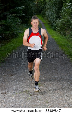 athlet running through the forest