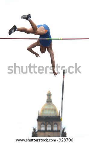 Athlete clearing the bar during a pole vault event in Prague, Czech Republic (some noise)