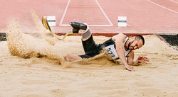 athlete disabled amputee on prosthetic long jump in para athletics