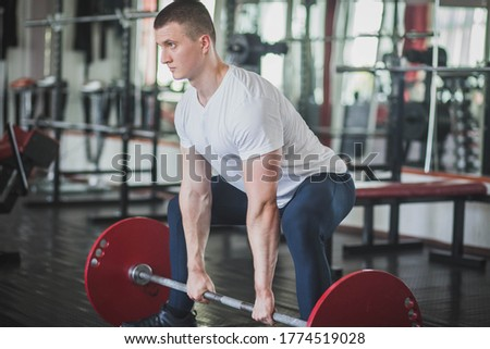athlete doing deadlift n style sumo in gym Foto stock ©