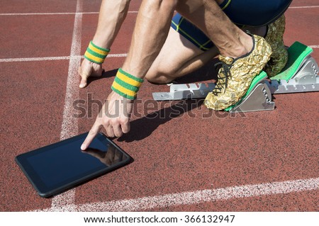 3626f9c27fc8b2 Athlete in gold running shoes crouching at the starting line of a running  track wearing Brazil