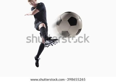Athlete kicking soccer ball Stock photo ©