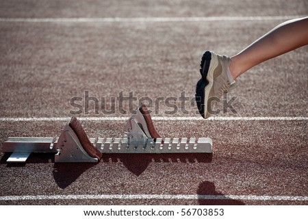 Athlete leaving the starting blocks for a sprint run on a track
