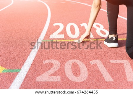 Athlete on Starting line waiting for the start in running track with text 2017 year, Start to new year #674264455