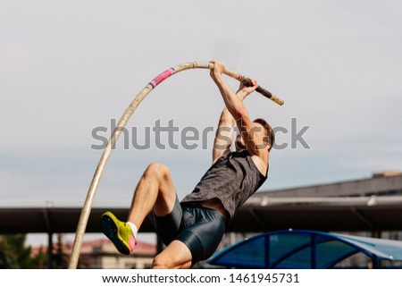athlete pole vaulter to pole bend during athletics competition