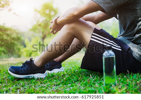 athlete resting on green glass...