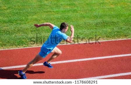 Athlete run track grass background. Runner in motion. Man athlete run training. Many runners like challenge of extending their endurance without having to do training necessary to finish marathon. #1178608291