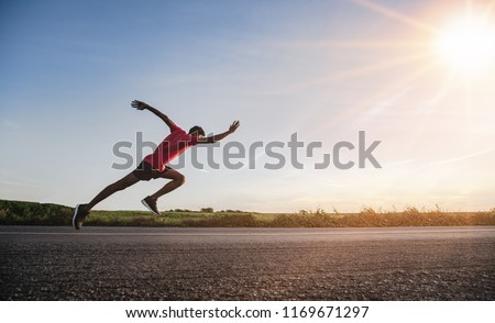 Athlete runner feet running on road #1169671297