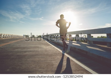 Athlete runner feet running on road #1253852494