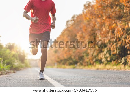 Athlete runner feet running on road, Jogging concept at outdoors. Man running for exercise. Stock foto ©