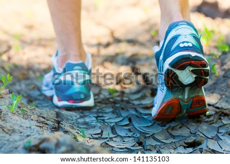 athlete running sport feet on trail healthy lifestyle