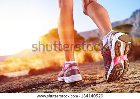 athlete running sport feet on trail healthy lifestyle fitness #134140520