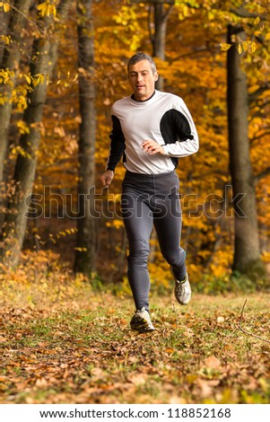 athlete running through the forest