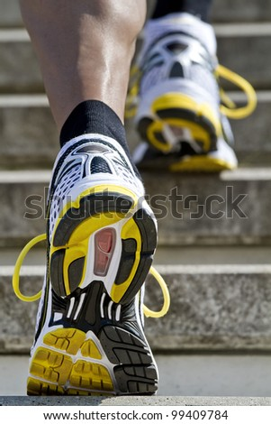 Athlete runs up the stairs