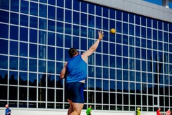 athlete shotputter shot put in athletics competition