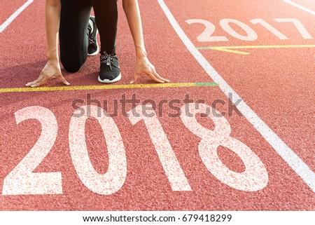 Athlete Starting line waiting start running track with text 2018 year, Start to new year next future