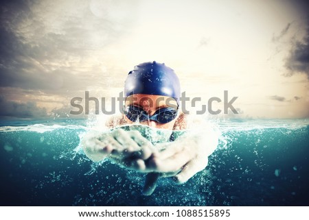 Athlete swims in a blue deep water #1088515895
