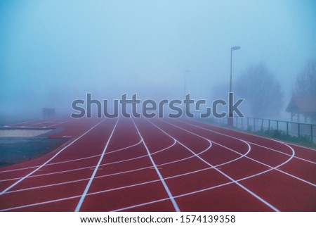 Athlete Track or Running Track with blue misty background