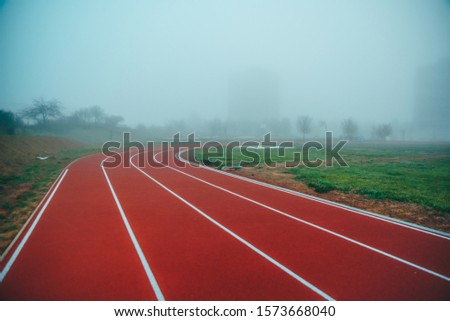 Athlete Track or Running Track with blue misty background. White edit space