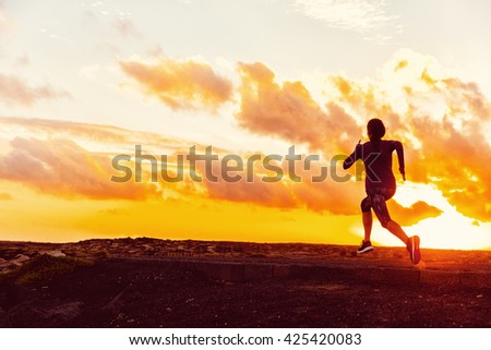 Athlete trail running silhouette of a woman runner at sunset sunrise. Cardio fitness training for marathon race. Active healthy lifestyle in summer nature outdoors. Goal achievement challenge concept. #425420083