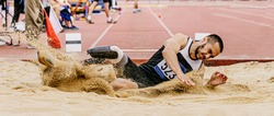 athlete with disability in prosthetic long jump in para athletics