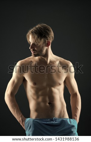 Athlete with fit body in shorts. Training and workout activity in gym. Man with six pack and ab muscles. Sportsman with sexy torso and chest. Sport or fitness and bodycare concept.