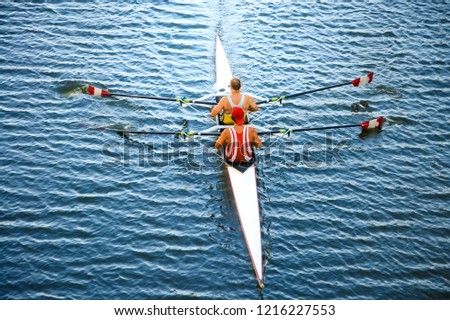 Athletes on a canoe. Kayaking and Canoeing. Sport and competition concept background.