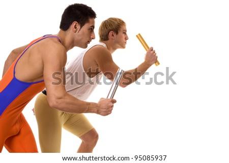 Athletes Racing Relay - stock photo