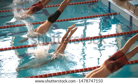 athletes swimmers dive into the water. Swimming paths in the pool. Selective focus. #1478747150