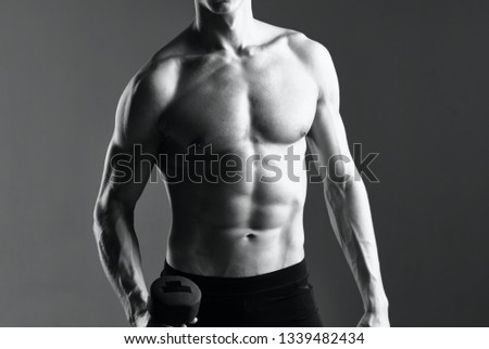 Athletic athletic male athletes descended to the nude torso against a gray background workout fitness