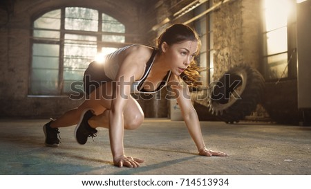 Athletic Beautiful Woman Does Running Plank as Part of Her Fitness, Bodybuilding Gym Training Routine.