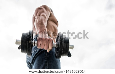 athletic body. Dumbbell gym. Muscular man exercising in morning with barbell. fitness and sport equipment. Healthy lifestyle. athletic man sportsman weightlifting. steroids. copy space.