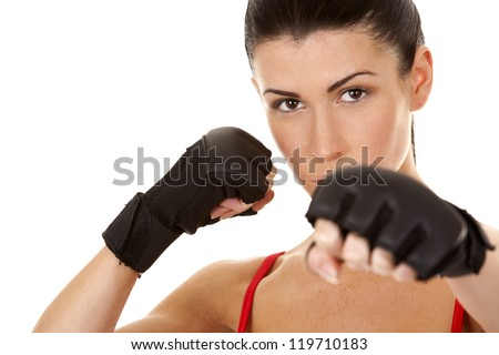 athletic brunette wearing boxing gloves on white isolated background