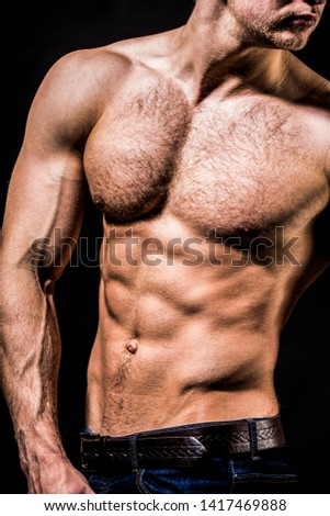 Athletic caucasian, ab, six pack, chest muscles, triceps. Strong mans, bodybuilder, muscular men. Beautiful male torso.