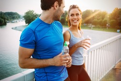 Athletic couple jogging together outdoors