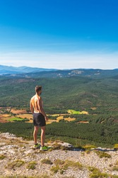 athletic healthy young man hiking in a sunny summer day in the mountains of Palencia, Spain. Lifestyle concept