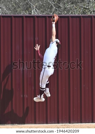 Athletic High School baseball players participating in an game Stock photo ©