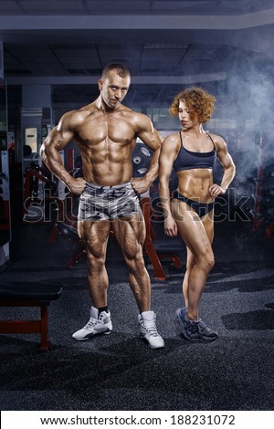 Athletic man and woman after exercise in gym