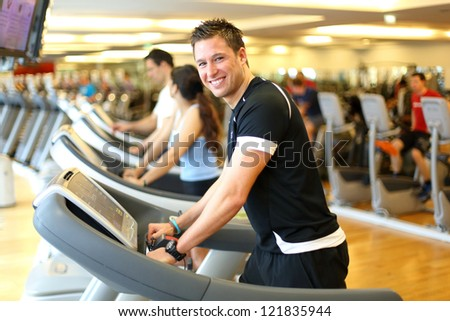 Athletic man during training on a treadmill