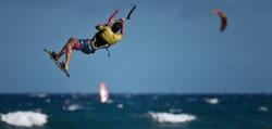 Athletic man jump on kite surf board on a sea waves