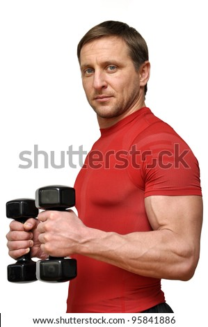 Athletic man with a dumbbells over white
